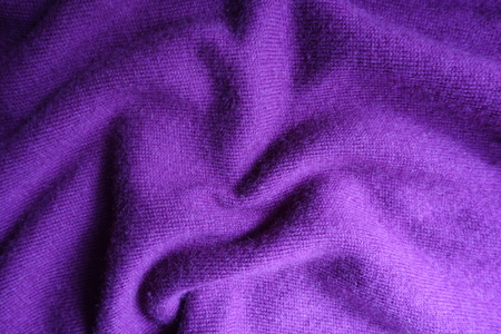 Soft folds on bright violet knitted fabric Stok Fotoğraf