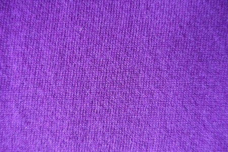 Texture of plain thin violet knitted fabric