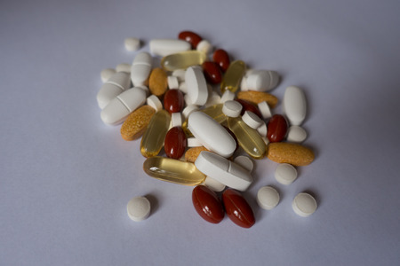 Multivitamins, lutein, calcium, vitamin K and fish oil pills 写真素材