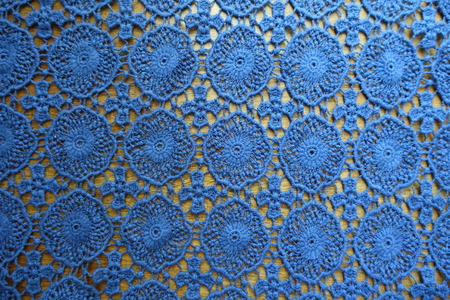 Lacy cotton fabric on wood from above