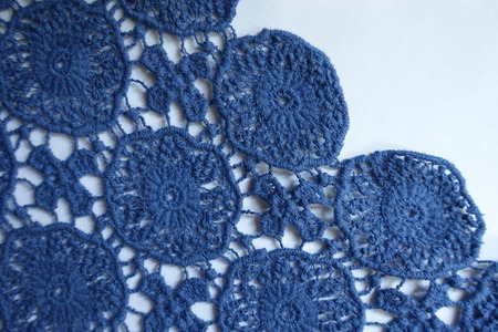 Selvage of pale blue old fashioned lacy fabric