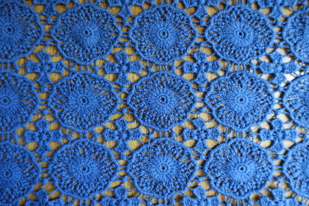 Thin blue lacy fabric on wood from above Foto de archivo