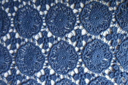 Vintage blue crochet lace on white background from above