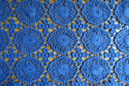 Vintage lacy fabric on wood from above