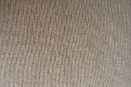 Basic beige knitted fabric made with stocking stitch