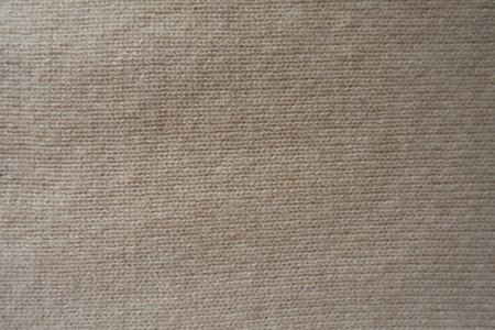 Cream colored handmade knitted fabric from above Stock Photo