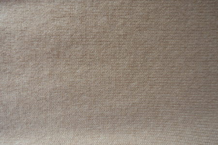 Simple handmade beige knitted fabric from above