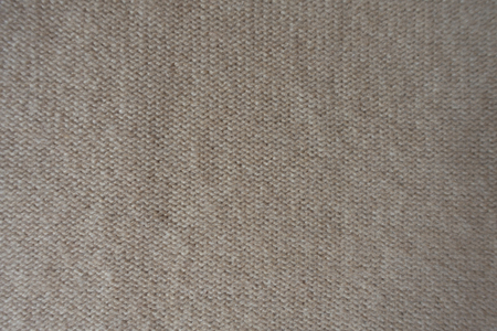 Top view of wrong side of beige knitted fabric