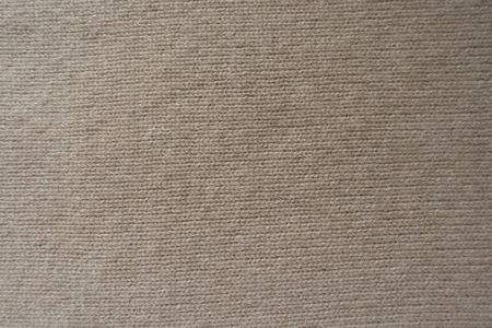 Background - simple beige knitted fabric from above