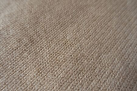Diagonal view of simple handmade knitted fabric