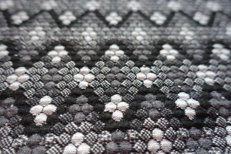 Macro of thick grey cotton fabric with geometric pattern