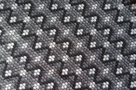 Surface of thick grey cotton fabric with diagonal geometric pattern