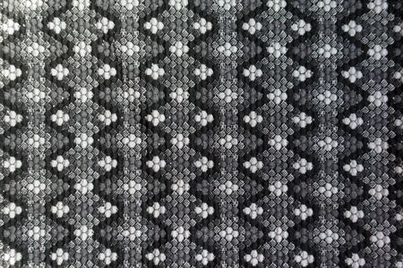 Thick grey cotton fabric with geometric pattern from above