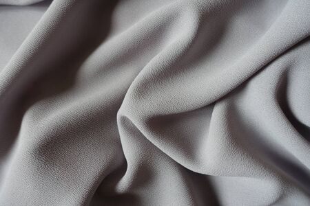 Grey crepe georgette fabric in soft folds Imagens