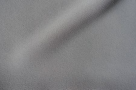 Single diagonal soft folds on grey crepe georgette fabric