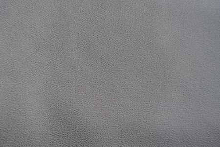 Surface of grey crepe georgette fabric from above