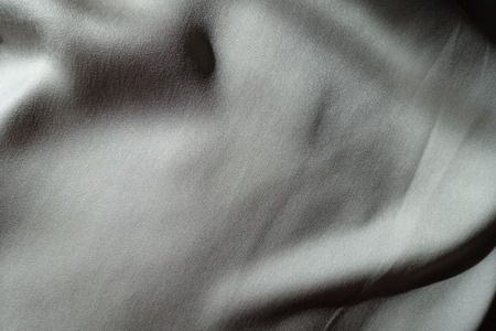 View of light grey chiffon fabric in soft folds from above