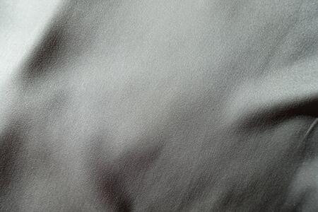 Surface of light grey chiffon fabric in soft folds 写真素材