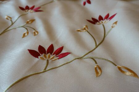 White cloth with old fashioned floral embroidery