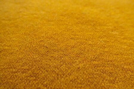 Close view of amber yellow woolen fabric