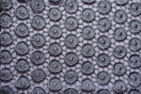 Light grey lacy fabric directly from above