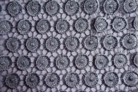 Top view of silver grey lacy fabric