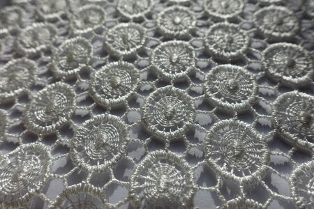 Close shot of ivory white lacy fabric Imagens