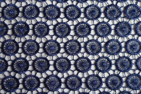 Navy blue lacy fabric directly from above Imagens