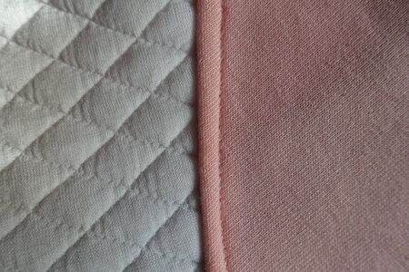 Vertical seam between white padded fabric and pink one Banco de Imagens