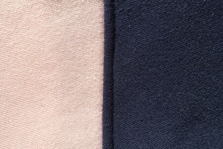 Vertical seam between pink and navy blue jersey fabric