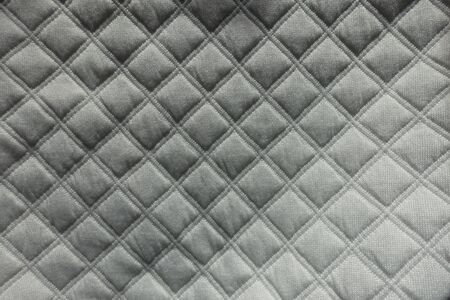 Top view of white quilted fabric with diamond pattern 写真素材