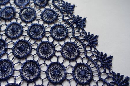 Edge of navy blue crochet lace fabric Imagens