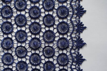 Vertical edge of navy blue crochet lace Imagens