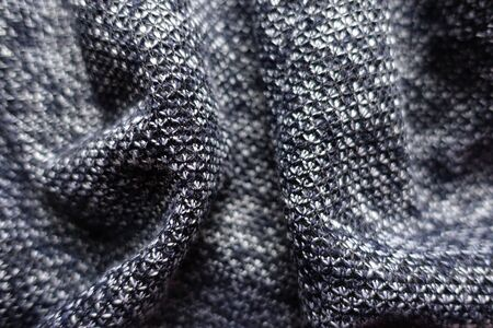 Closeup of draped thick heather blue gray fabric