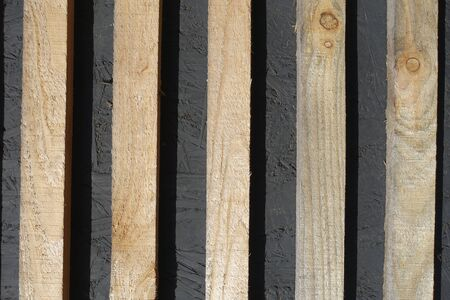 Vertical unpolished and unpainted thin wooden planks
