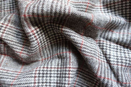 Draped red and grey Glen check woolen fabric 免版税图像