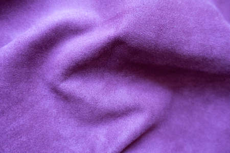 Draped violet faux suede fabric from above