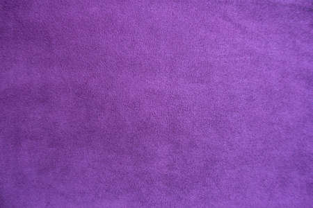 Texture of violet faux suede fabric from above