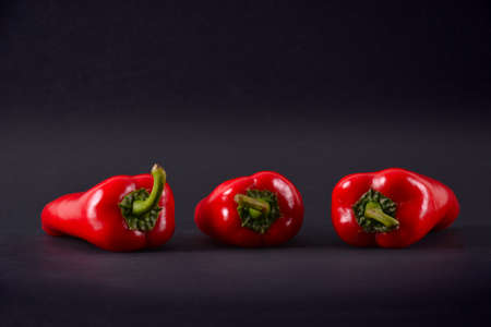 Red peppers on a black background. Ajvar photo