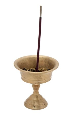 Buddhist incense in a brass bowl photo