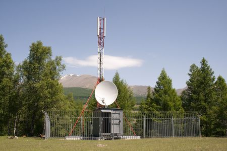 GSM cell phone antenna tower in the forest photo