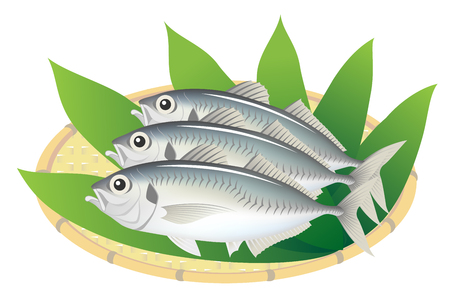 The horse mackerels on a bamboo basket, isolated on the white background.