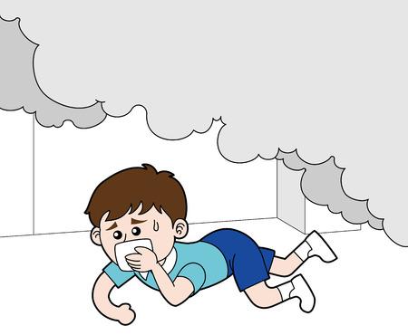 Un garçon rampant sous la fumée d'un incendie