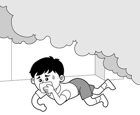 A boy crawling under smoke of a fire
