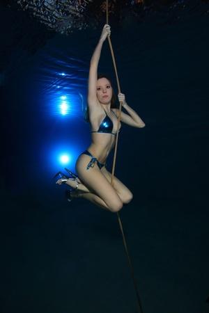 swim shoes: Underwater model Stock Photo