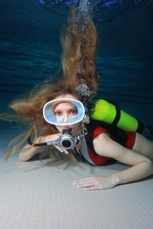 monokini: Woman scuba diver Stock Photo