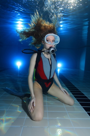Woman scuba diver in the pool photo