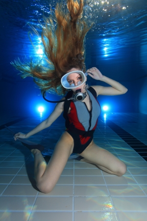 Woman scuba diver posing in the pool photo