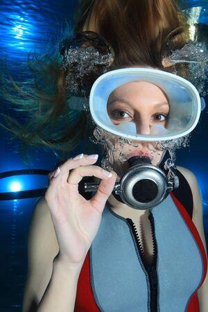 Woman scuba diver show hand signal