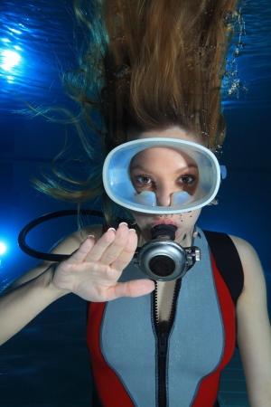 monokini: Woman scuba diver show hand signal